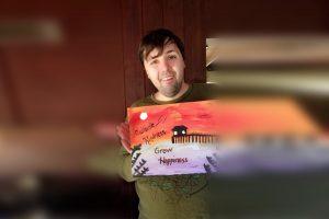 portrait of person holding artwork