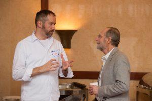 portrait of two men having a conversation