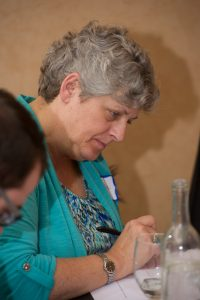 photo of woman writing