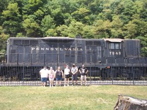 group portrait in front of a train